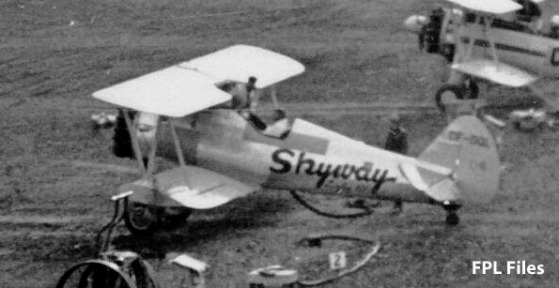 Skyway CF-DQL in a line of Stearmans parked at Budworm City, NB, in the 1950s. Taken from the control tower. Scanned from a print from the FPL files.
