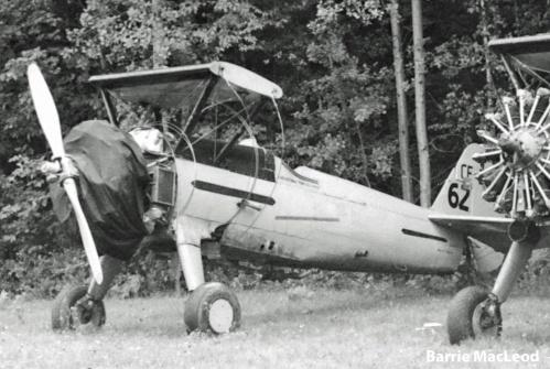 Wheeler Stearman CF-EQT #62 stored beside her sister CF-EQS. Fredericton, NB, 11 August, 1975. [Barrie MacLeod]
