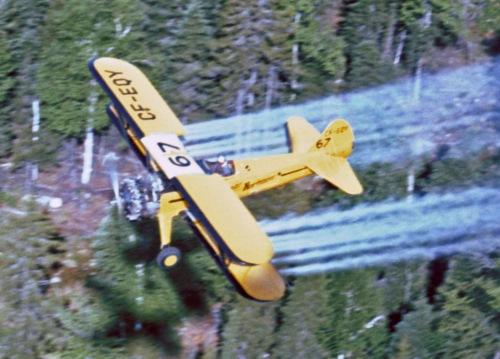 Stearman #67 CF-EQY spraying, Juniper NB, June 1967