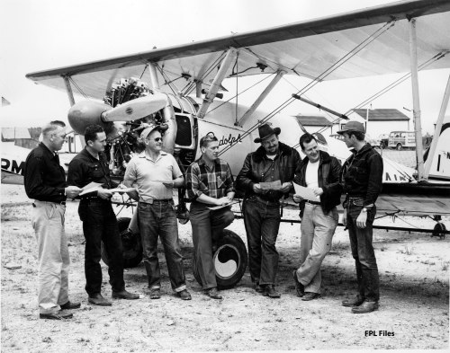 Pilots and crew at camp, probably 1953, with Stearman. Mac McGlothin is in the black hat. [FPL Files]