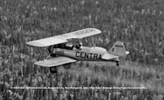 #2 N55256 (not N55258) spraying, Central Aircraft. Budworm City, New Brunswick, June 1952. Bauman series, Forest Protection Limited files.