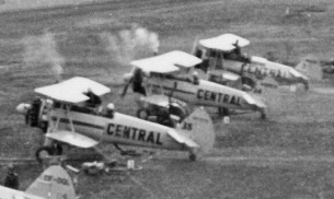 - #35 Nxxxxx, #34 Nxxxxx and # 7 N57315 at end - Budworm City, 1953. The only two Central Stearmans with an anterior stripe.
