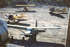 - #41 N4787V, #45 Nxxxxx and unknown - Stearmans at Boston Brook airstrip, 1953, Mac McGlothin image.