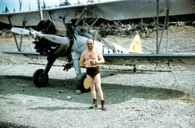 - #8 N1262N - Central Stearman parked, pilot in bathing suit. The N# is above the tail #, not to the right as in the 1952 image, Hi-114c2. Assuming this is from 1953.