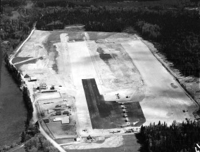 Aerial view of Nictau Airstrip looking north. The control tower is at the lower end near the corner of trees. Richard Arless Assoc., Nictau, NB, 27 May to 2 June, 1953.