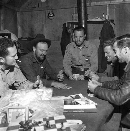Playing cards: L to R: Hank Jon (?), Mac McGlothin, Andy Pillar, Kelly Wells, Chuck Harris. Dwight Dolan, New Brunswick, 7-13 June, 1953.