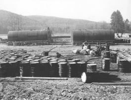 Storage tanks and drums of DDT, Nictau Airstrip. Richard Arless Assoc., Nictau, NB, 27 May to 2 June, 1953.